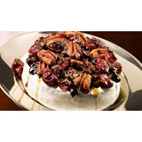 Warm Brie with pecan, cranberry and dark chocolate topping | IGA Recipes
