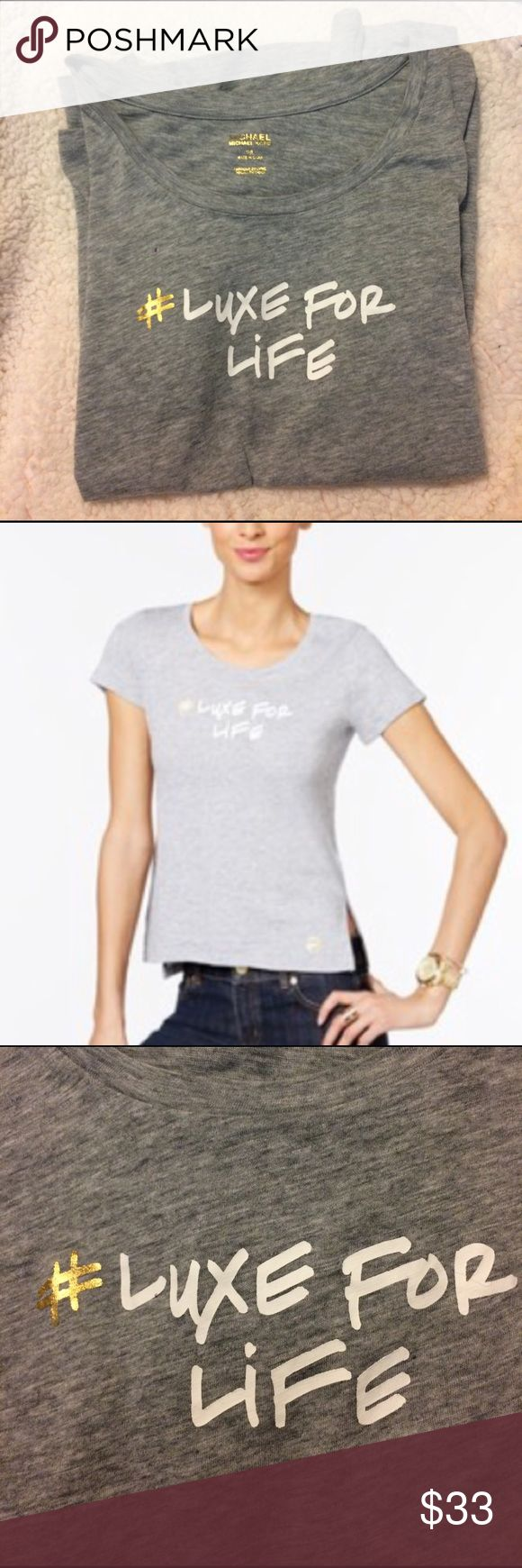 """Michael Kors Graphic T-shirt MICHAEL Michael Kors gray """"#Luxe For Life"""" Graphic T-shirt.  Light gray tee with gold and white graphics.  Scoop neckline, pullover tee, slits at side hems, sits at hip, 100% cotton. Shoulder to hem 23""""/24.5"""".            🚫trades MICHAEL Michael Kors Tops Tees - Short Sleeve"""