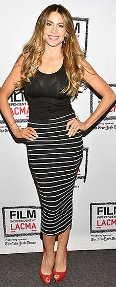 The Modern Family actress sizzled in a black tank and striped body-con midi skirt. Red peep-toe heels added a sexy flair.