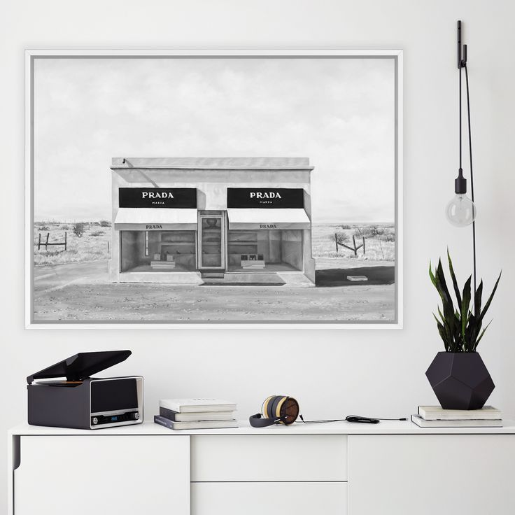 Featuring the iconic art & sculpture desert town of Marfa and the installation faux retail store by a well known Italian luxury design house & set against a baron desert road, this canvas print was originally hand painted by our in-house artist team, and now available as a reproduction stretched and ready-to-hang canvas art piece. Size & frame colour options available. We ship worldwide. #ThePrintEmporium #marfa #blackandwhite #art #canvas #print #desert #wallart #luxury #fashion…