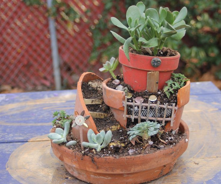 I saw a kit for a fairy garden in a big box story and was blown away. They were offering a cheap plastic terracotta colored pot base with cheap fairy type accessories for $25.00. Determined not to be hoodwinked by buying such an item while parting with my $25.00 I decided to make my own.