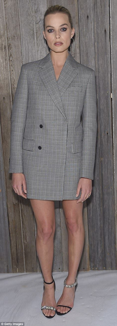 Howdy, partner!Nicole Kidman donned her own take on Nashville chic while attending Calvin Klein's New York Fashion Week show on Tuesday alongside fellow Australian actress Margot Robbie