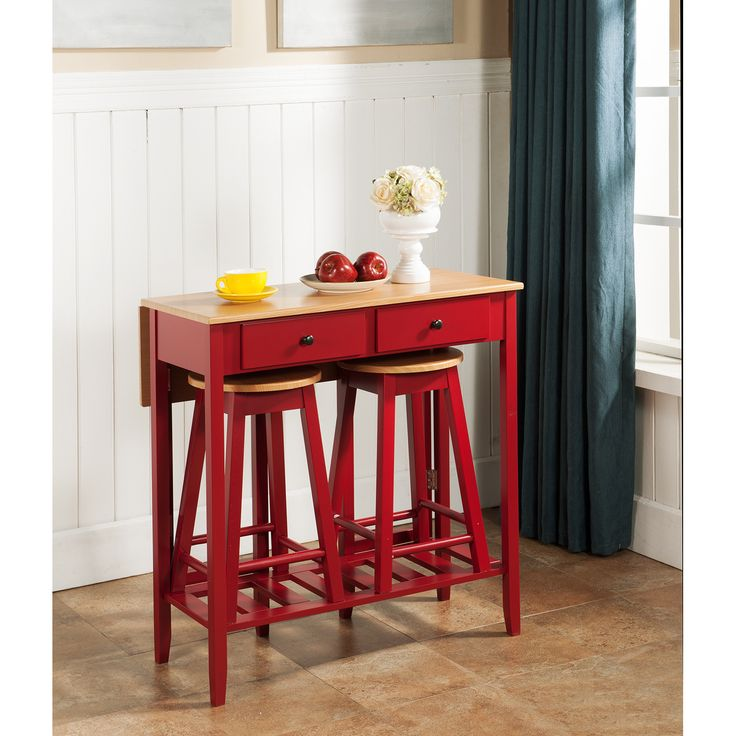 Have a casual meal with this K&B Pub set featuring a table and two (2) stools. The red finish is enhanced by a light brown table and stool topper that will complement your kitchen decor. The pieces fit together nicely for easy storage.