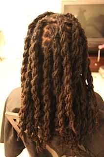 Two strand twisted Locs styled by ShawnaLocsNBraids.