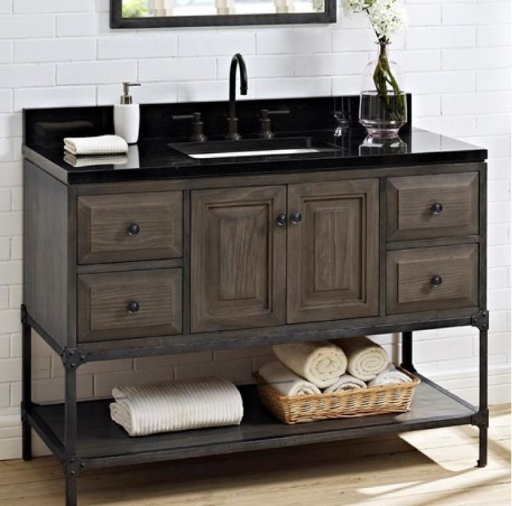 Gallery Website Toledo blends a clean lined profile with machine age details in a modern approach to bath decor Decorative rivets on cabinet and mirror provide a chic