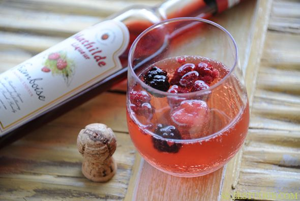 @kendrafoote White wine sangria with champagne and frozen berries.... Yes, please!!!!!