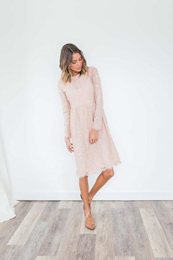 *Pre-order estimated ship date is February 3rd.* Long sleeved lace dress. Main body lined. Cinched waist and scalloped hem. Keyhole button back. Model wearing a size small Runs true to size