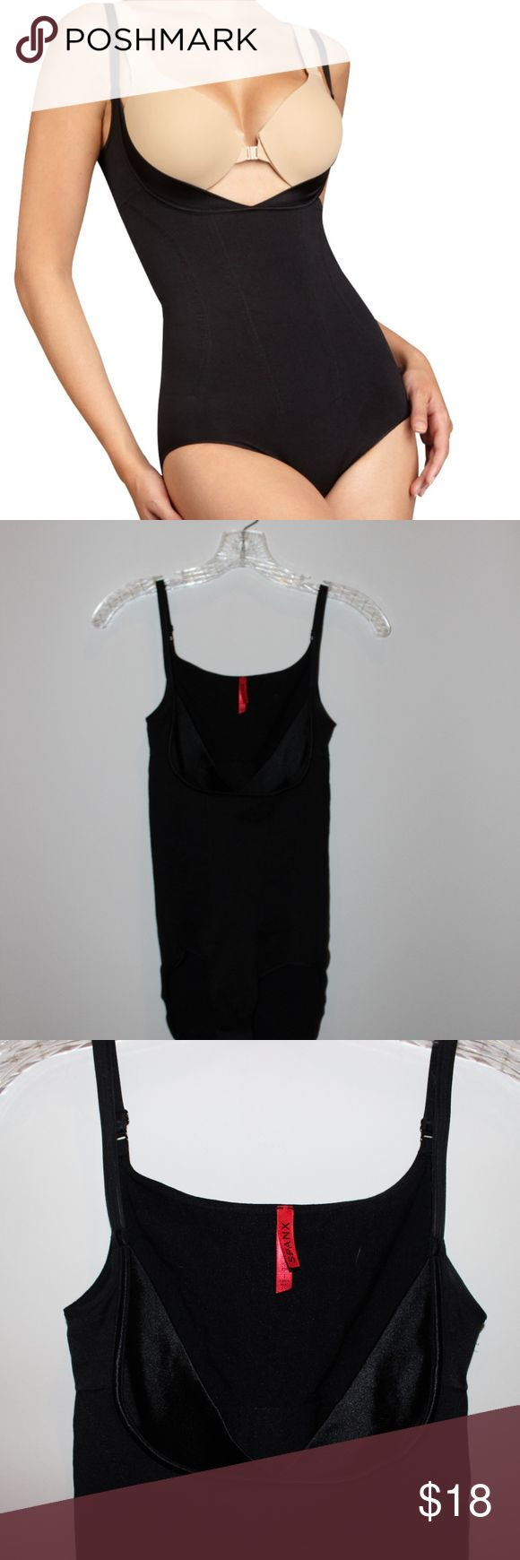 Spanx bodysuit Size 1. Worn once. Fits true to size. No flaws or signs of wear. Has bra-like closure on bottom.  Feel free to ask any questions regarding measurements. SPANX Intimates & Sleepwear Shapewear