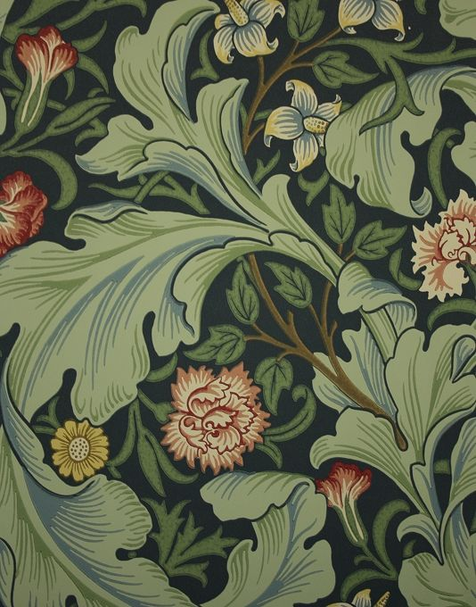 Leicester Wallpaper A block printed inspired floral wallpaper of pink and yellow flowers and flowing leaves in sage on a woad background.