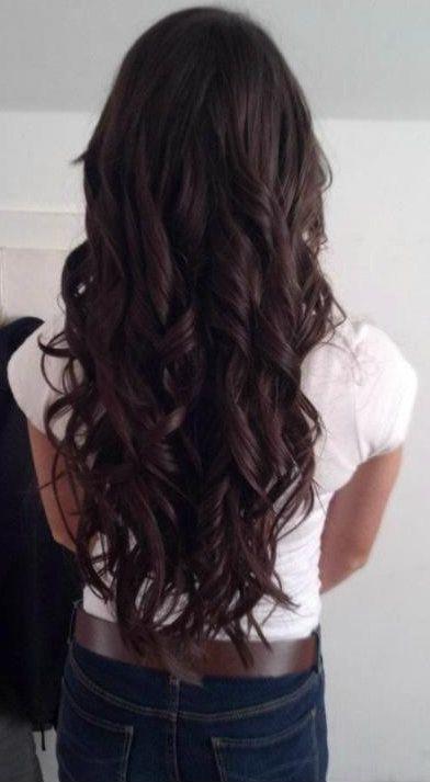 Long, curly, dark brown hair.