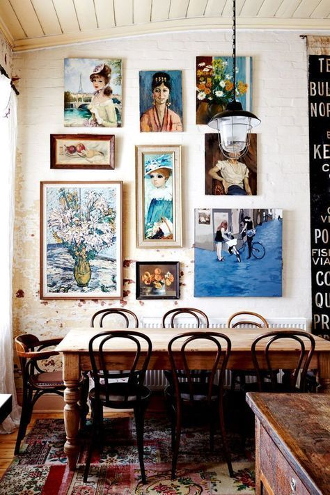 Eclectic interior decor, vintage eclectic dining room with wooden table and wall gallery, vintage rug, vintage interior decor