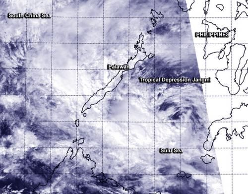 NASA-NOAA's Suomi NPP Satellite sees strong wind shear tearing Jangmi apart