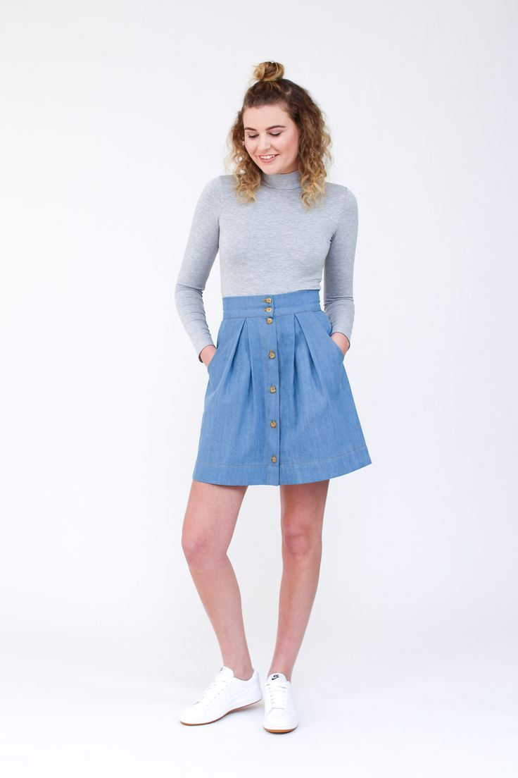Kelly skirt sewing pattern by Megan Nielsen: Button front pleated skirt with pockets. Pattern sits on the natural waist and features button front placket, wide waistband, large scoop pockets and pleating in the front and back.