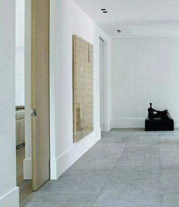 gallery white minimal entrance hall | foyer | pale oak doors | artworksPiet Boon