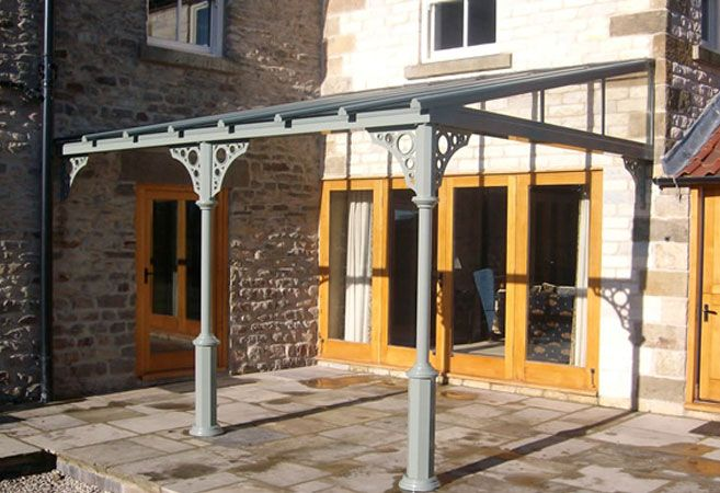 traditional veranda with gray frame by nationwide home innovations