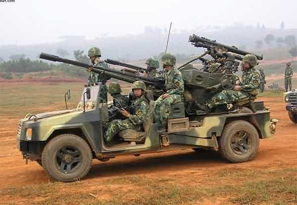"""The mainstay of the Fire Support Co (FSC) is """"Brave Warrior"""" Fast Attack Vehicle (FAV) that has been in service with PLA airborne and special operations. New model FAV - Iron Eagle - also deployed in several new armament configurations not seen in PLA service before. Minigun of undetermined caliber, W99 82mm Automortar, air defense versions are armed with the Type 87 twin 25mm cannon and dual HN-5 surface-to-air missiles, and HJ-8 antitank guided missile launcher (ATGM)."""