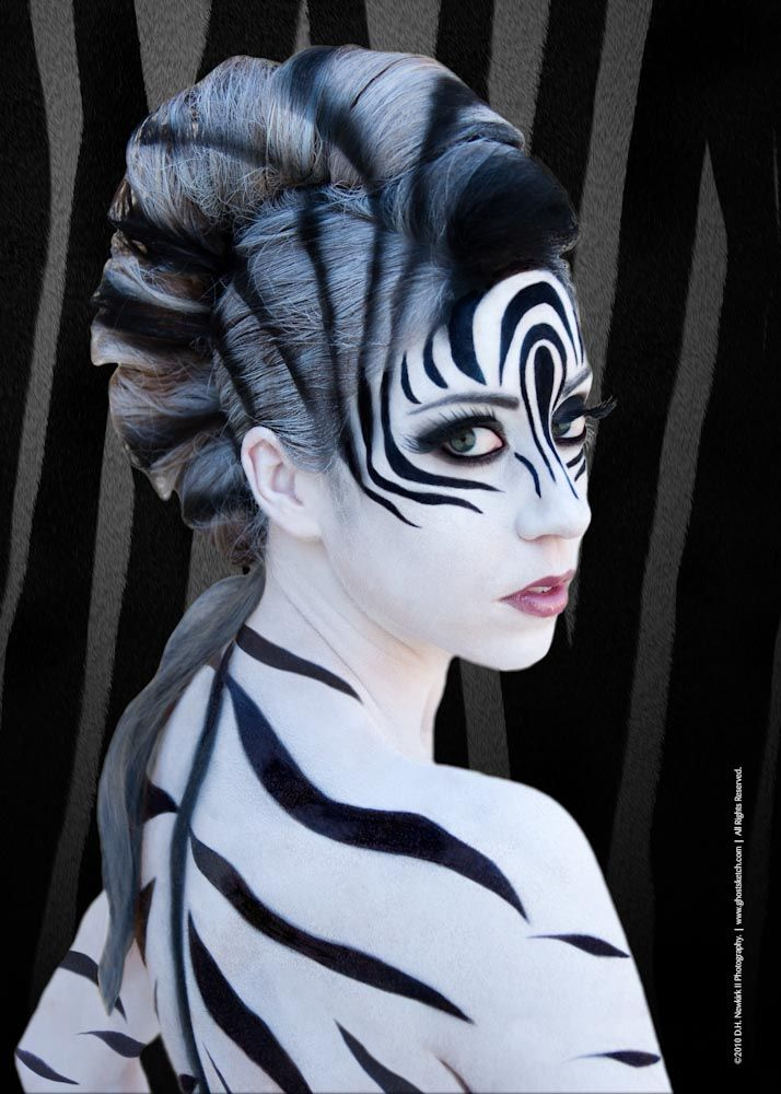 Zebra Makeup add a french roll, some black and white hairspray and then complete with makeup.  Great for a jungle party.  #animal #makeup #ideas