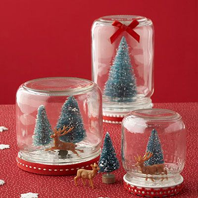 Signature snow globes~~ OK not the ones I was looking for... Use empty jars and glue any Christmas Ornament to lid. Fill Jar with baby oil and crushed egg shells or glitter. The babt oil makes the snow move more slowly...