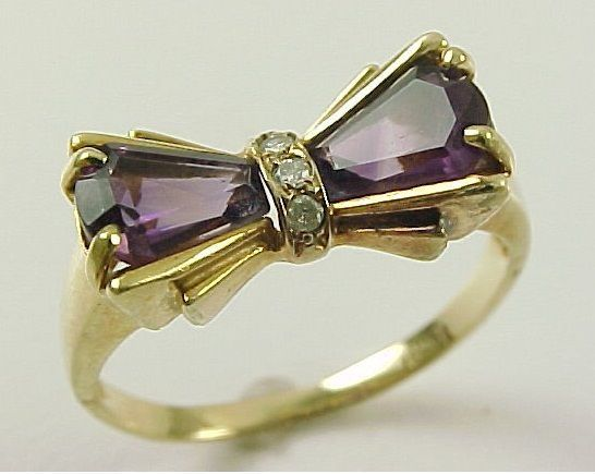 I think Im obsessed with bow engagement rings. found at www.rubylane.com