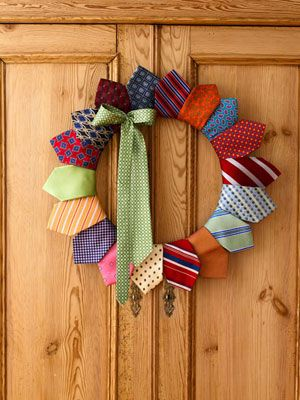 A wreath made from neck ties...I might make one using christmas ties. Use a 14-inch wire wreath form from a crafts shop and 19 ties. Cut all ties but one into 15-inch lengths. Position the narrow end of first cut tie, front side up, on a section of the wreath. Wrap tie around form until pointed end is positioned as shown, hiding the rolled tie; secure with pins. Repeat, overlapping ties slightly. Flip wreath over; sew rolled-up ties to the backs of points. Pin on the uncut, bowed tie.