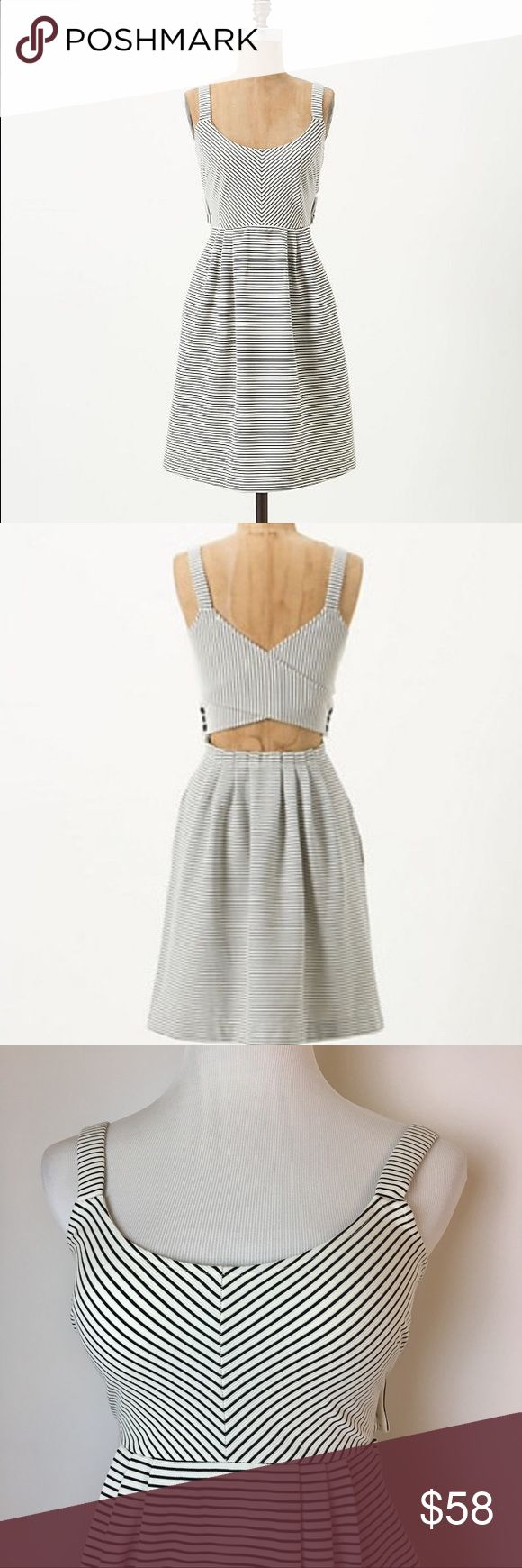 NWOT Postmark striped cross back dress Sweet textured jersey navy and white striped dress. Scoop neck. Wide crossed bands across the back that button on the sides and give a peek at your back. Side pockets and hidden zipper at the side of the skirt. The fabric is heavier weight so it holds its shape well. Perfect for hot summer days! Anthropologie Dresses