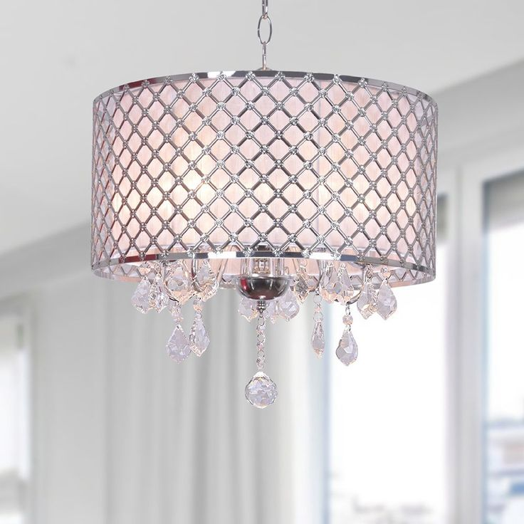 Give your home a modern yet elegant look with this Carina chromed-finished chandelier. Accented by clear crystals, this chandelier requires five 60-watt Candelabra bulbs (not included).