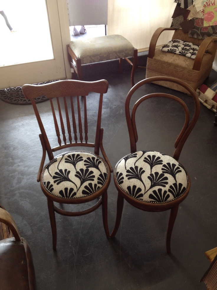 A pair of dining chairs made to match with lovely fan patterned fabric.