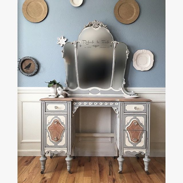1930's Montgomery Ward vanity in @dixiebellepaint Driftwood & Buttercream. Glass floral knobs from @dlawlesshardware. #rehabtofab #dixiebellepaint #chalkpaint #paintedfurniture #antique #antiquefurniture #antiquevanity #homedecor #home #diy