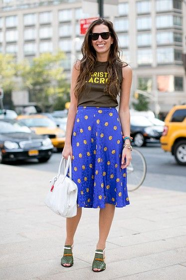 Love a ladylike skirt worn with a random athletic or vintage tee! #NYFW #OOTD #StreetStyle