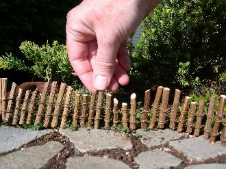 Little twig fence for fairy gardens - start saving your prunings.