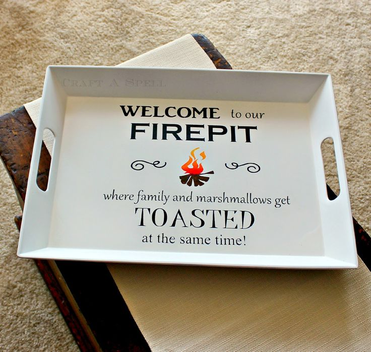 Welcome to our firepit where family and marshmallows get toasted at the same time serving tray