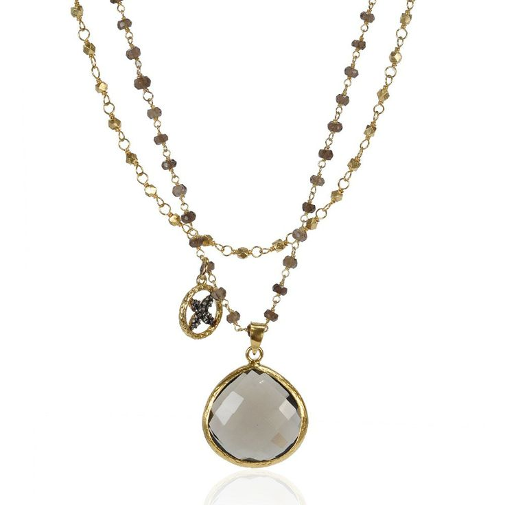 Two chains, one of delicate wire-wrapped smoky quartz gems and the other of 22K gold vermeil beads, hold a smoky quartz teardrop pendant and a sparkling CZ flower charm in this sweet layered piece from Coralia Leets.   www.secretgardengems.net