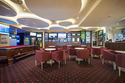 Ibis Lansvale has refurbished their  Tab gaming lounge with Wilsonart's Colombian walnut laminate.