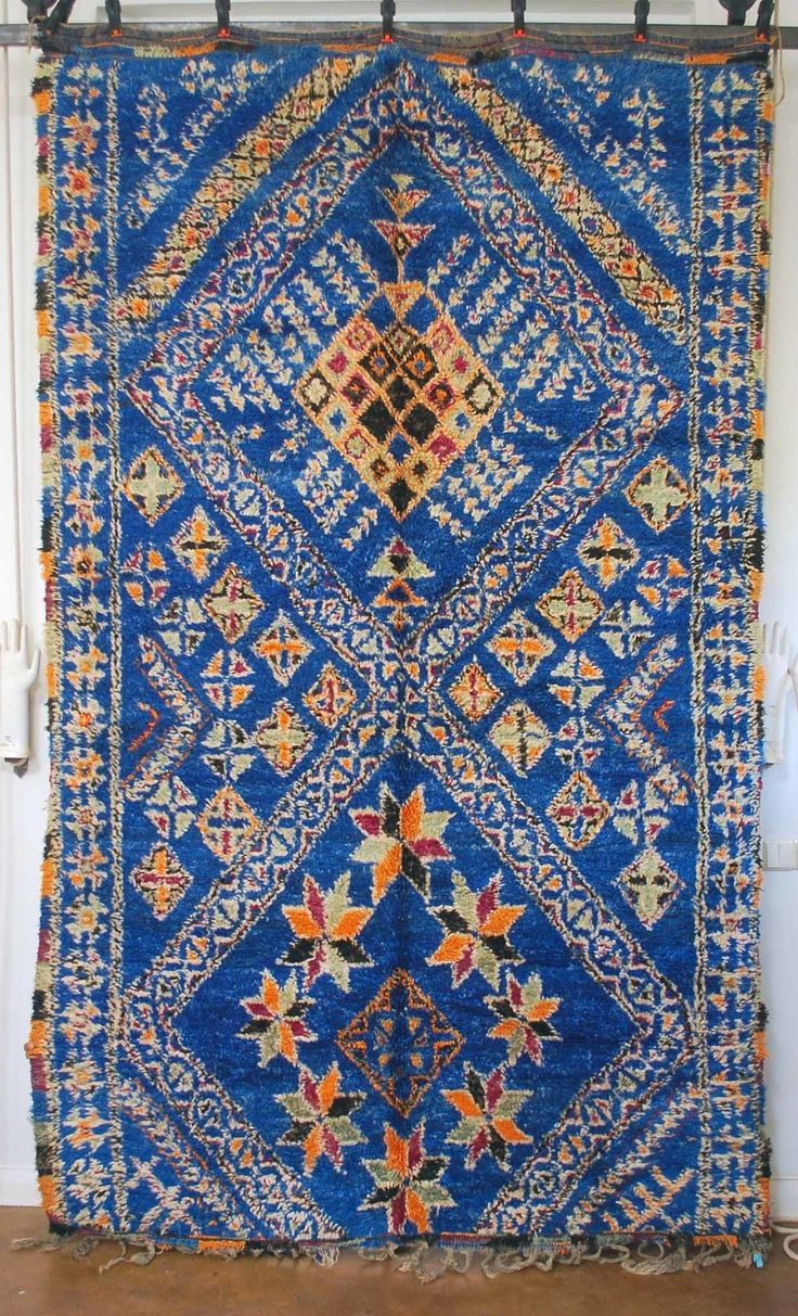 Use one of these to separate rooms  So rare - vintage Moroccan BLUE Beni Ouarain Rug.  From the Souk, by M.Montague.  Moroccan design