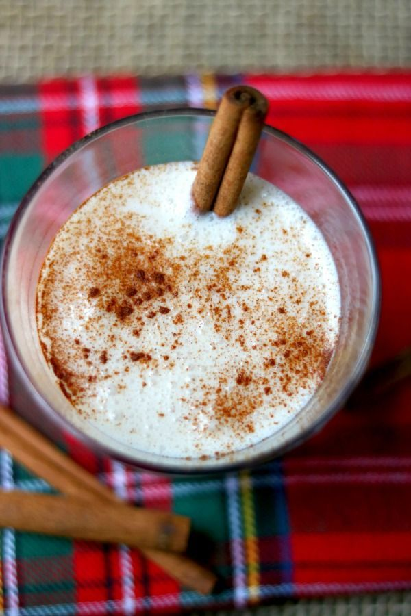 top view of a low carb coquito cocktail dusted with cinnamon - image 2 coquito recipe without eggs