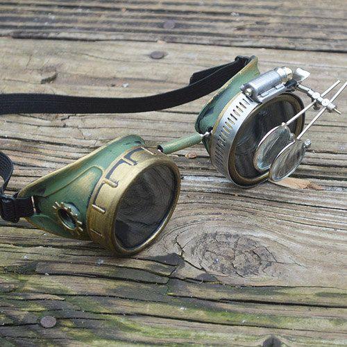 Occhiali Steampunk verde e oro con attrezzi dell