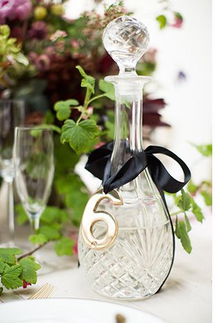 glass decanter table number | Read more on http://onefabday.com/pink-green-black-gold-wedding-table/