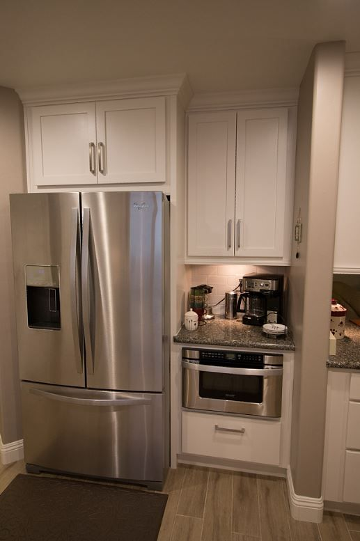 Starmark marshmallow cream cabinets with sharp mircowave for Quality kitchen cabinets
