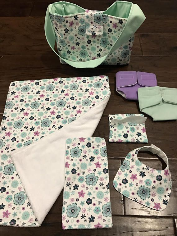 Perfect way to be just like mommy or daddy. This diaper bag comes with two cloth diapers, wipe case with wipes inside, burp cloth, bib, and a blanket. (Soft fabric may vary) Diapers fit 14-17 inch dolls best. This item makes the perfect gift for a special holiday, for a new baby
