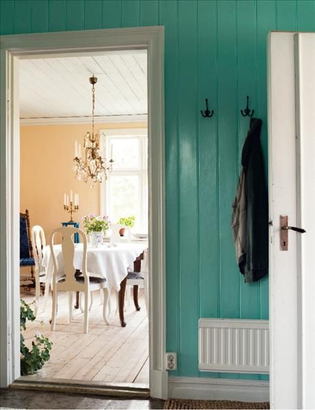 blue entry wall, yellow dine. Can I have a chandelier in every room?