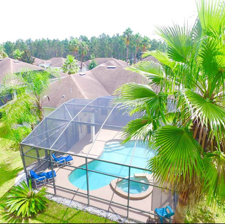"""Upon entering our villa there is a nice open living room overlooking the pool that is quiet and perfect for anyone needing a space from some of the """"hustle and bustles"""". There is a large sofa to relax on and direct access via patio doors to the pool deck.    Visit www.villaagogo.com for more like these Florida Villa's. #FloridaVillas #FloridaVacationRentals"""
