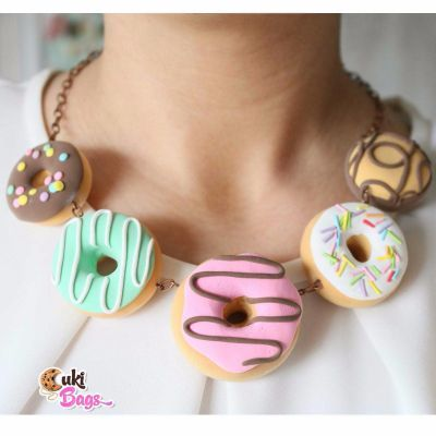 No matter what types of doughnuts you like, this handmade crazy FLAMBELOSA donut clutch/purse bag will make you stand out from the crowd. This handmade purse is glazed with mint and cherry icing, both colours mixed perfectly with the mint-blue-purple sprinkles ! WORLDWIDE DELIVERY - FREE SHIPPING for orders over $200;