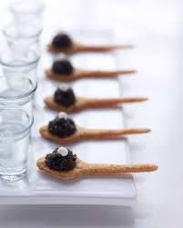 Peter Callahan's edible cracker spoons with caviar and creme fraiche ~ oh! and a shot of ice cold vodka, of course {Photo: Con Poulos} - Google Search