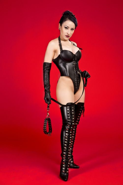 Dominatrix in thigh boots