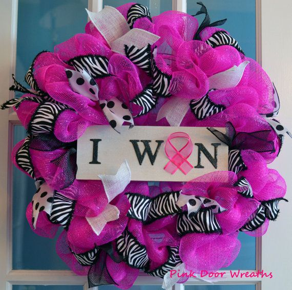 1 mesh I WON Breast Cancer Survivor wreath    Made with bright pink mesh and accented with lots of pink, black and white to showcase the sign in