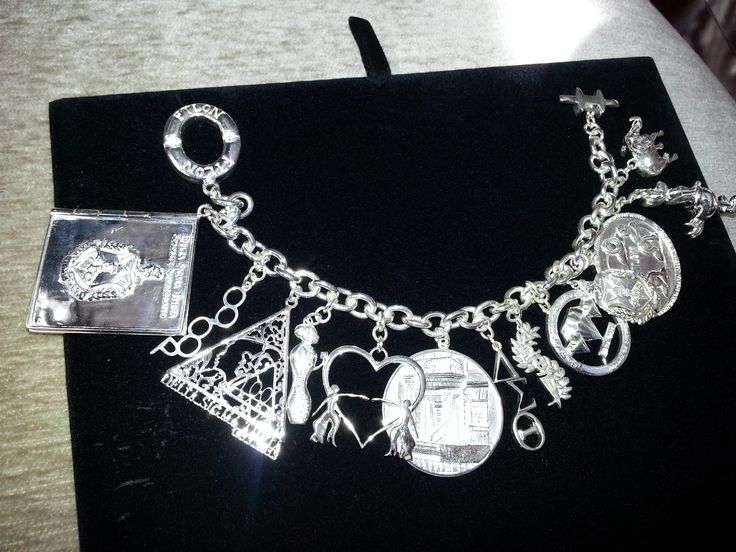 Sterling Silver Charm Bracelet With 13 Charms Reflecting Official