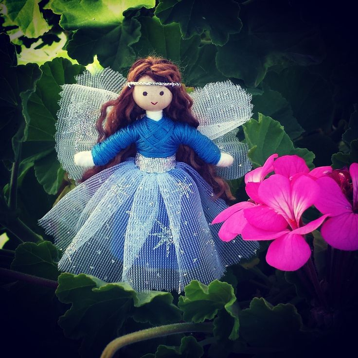 This beautiful little flower fairy is sure to delight any youngster or collector! Dressed in a lovely blue top and blue skirt with a white star glitter mesh overlay and silver belt she looks as though
