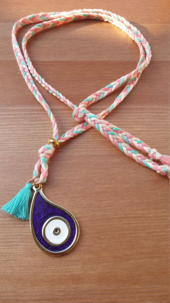 a colorful handmade necklace with a big purple spy by toocharmy
