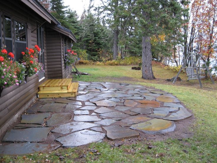 Flagstone patio deck patio pinterest for Backyard stone patio design ideas