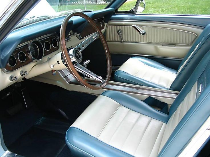 1966 Mustang Hardtop. Mine had the aquamarine and white Pony Interior.